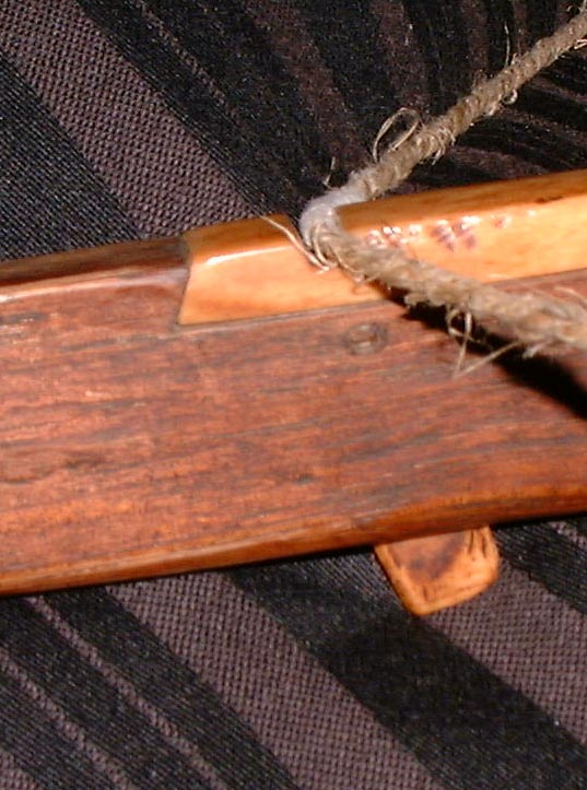 Nu nationality crossbow trigger mechanism.